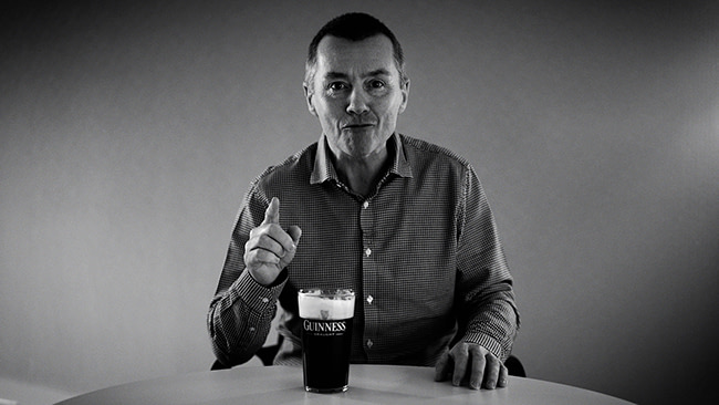 Willie Walsh the CEO of IAG, drinking a Guiness